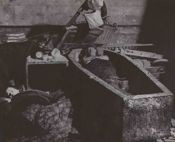 Bill Brandt, East End Crypt Shelter. Man Sleeping in a Coffin, 1940, gelatin silver print, Hyman Collection, London, © Bill Brandt/Bill Brandt Archive Ltd.