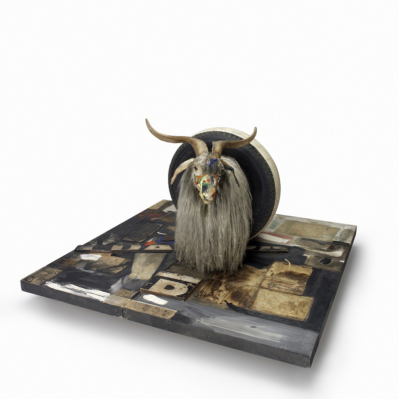 Monogram, 1955-59, Combine: oil, paper, fabric, printed reproductions, metal, wood, rubber shoe-heel, and tennis ball on  two conjoined canvases with oil on taxidermied Angora goat with brass plaque and rubber tire on  wood platform mounted on four casters, Moderna Museet, Stockholm. Purchase with contribution from Moderna Museets Vänner/The Friends  of Moderna Museet © Robert Rauschenberg Foundation, New York