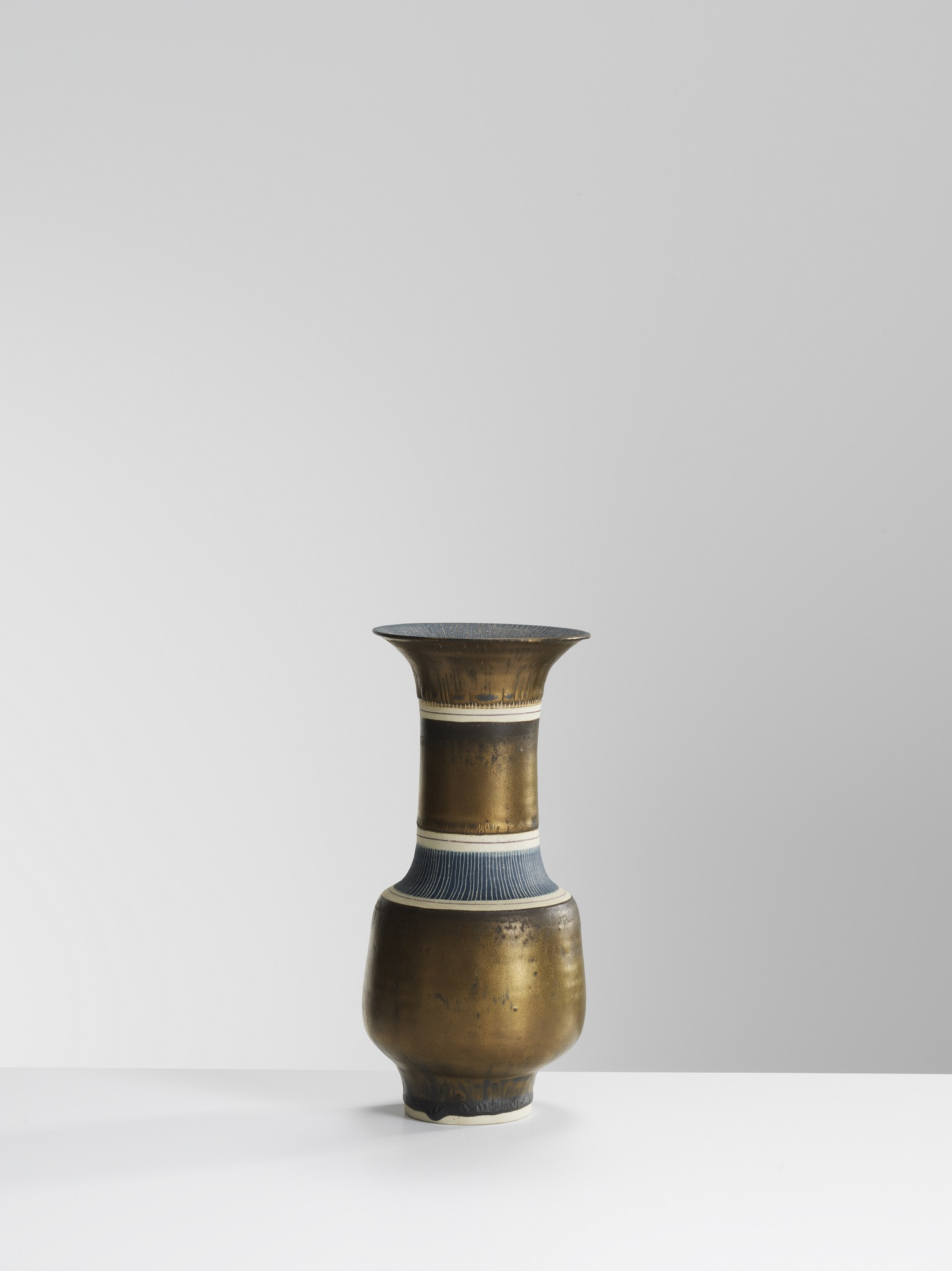 Lucie Rie, Bronze Vase with sgra ffi to, porcelain with manganese glaze (23 x 10.5 cms) Image: Michael Harvey