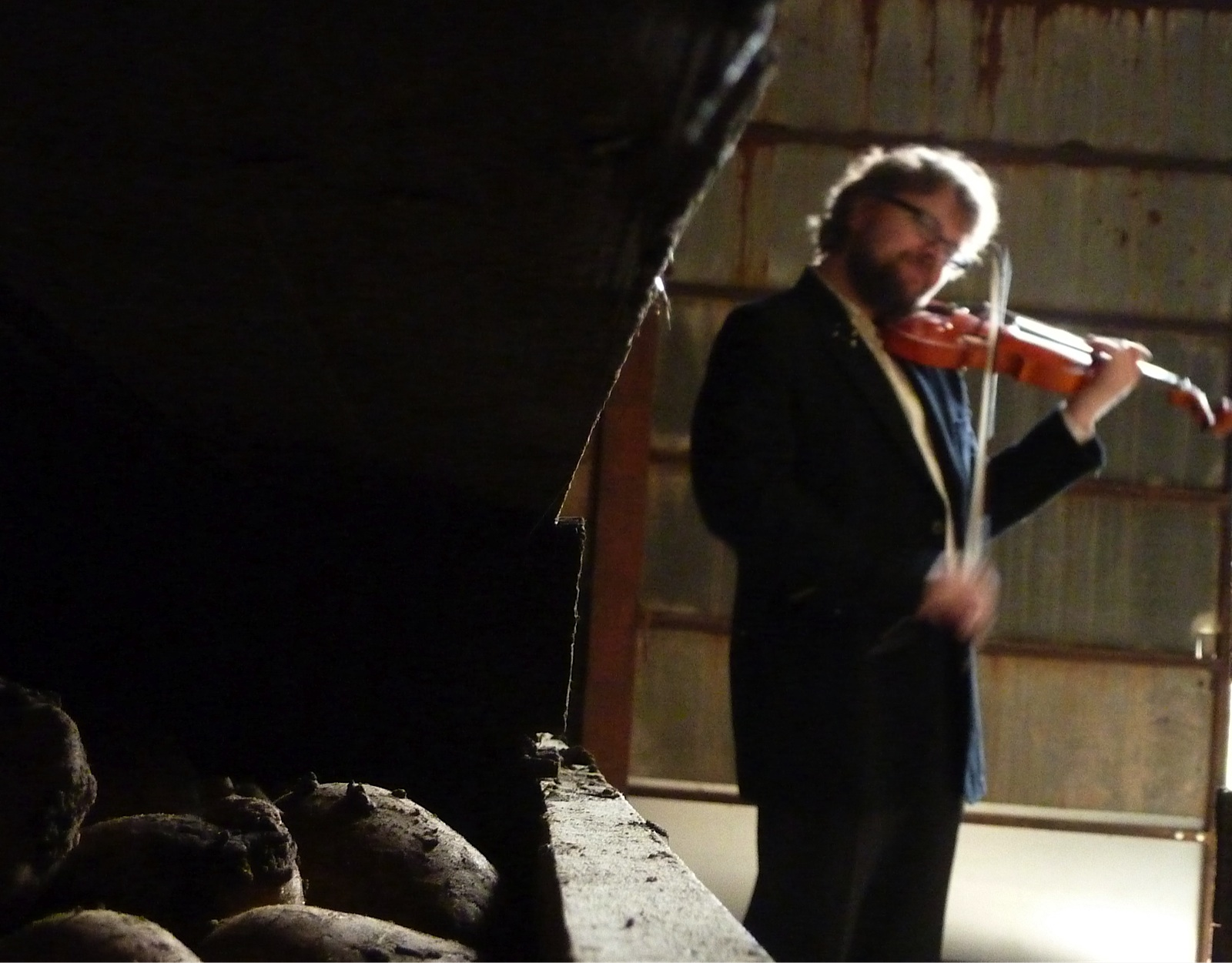 Violinist Alexander Janiczek in the Cambo potato barn