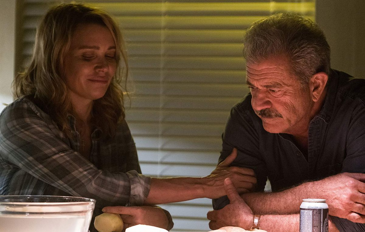 Melanie Ridgeman (Laurie Holden) and Brett Ridgeman (Mel Gibson) in Dragged Across Concrete