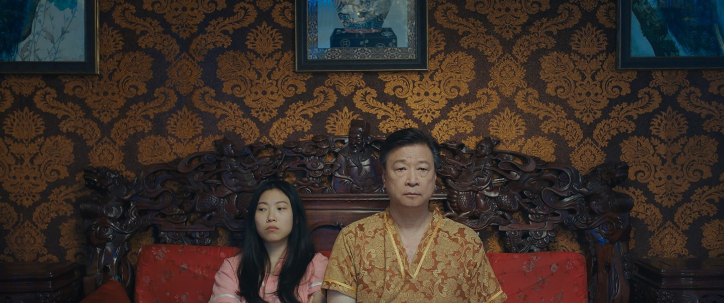 Billi (Awkwafina) and dad Haiyan (Tzi Ma) in The Farewell