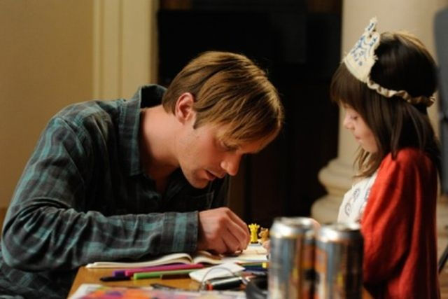 Alexander Skarsgard and Onata Aprile in What Maisie Knew
