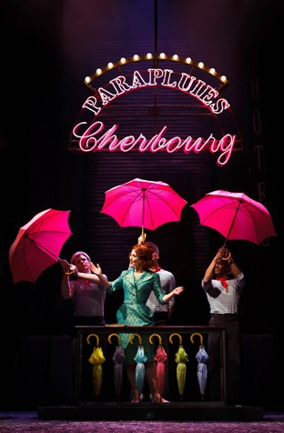 Joanna_Riding_Mdme_Emery_and_Sailors_The_Umbrellas_Of_Cherbourg_by_Steve_Tanner